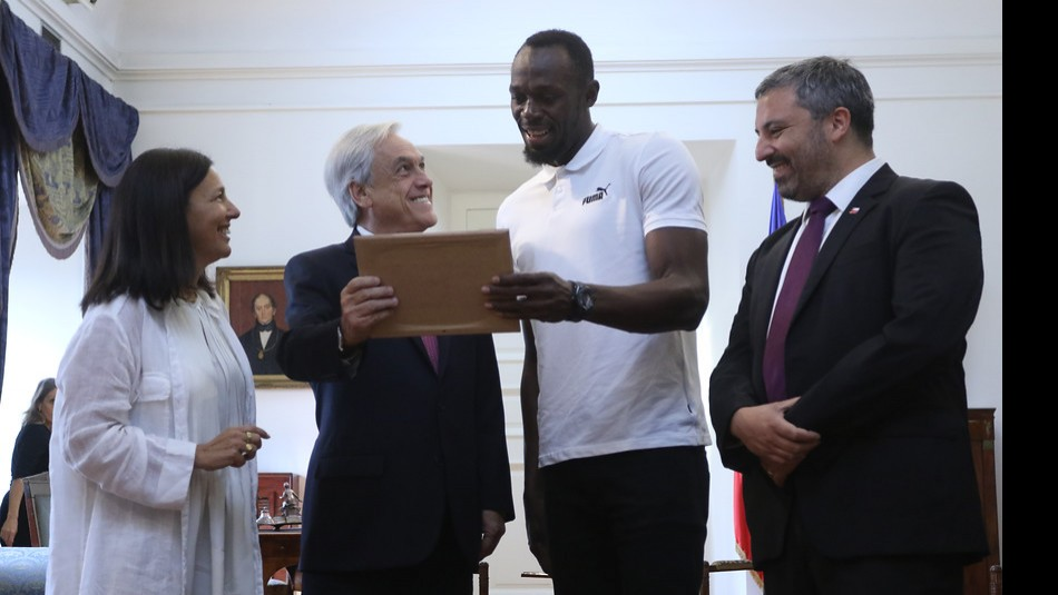 Usain Bolt visitó La Moneda. / Agencia Uno