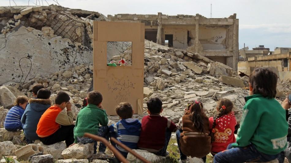 Abuelo de niños en Siria viajará este martes / AFP