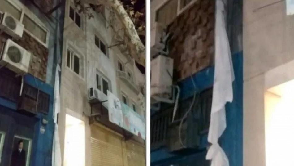 Joven escapa de residencia sanitaria atando sábanas para lanzarse por el balcón en Argentina