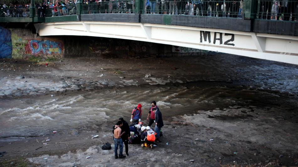 Mantienen en prisión preventiva a excarabinero acusado de empujar a joven al río Mapocho