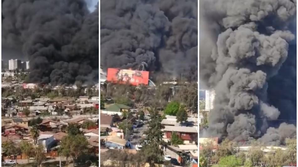 Incendio afecta a fábrica en la comuna de Macul: Columna de humo es visible desde larga distancia